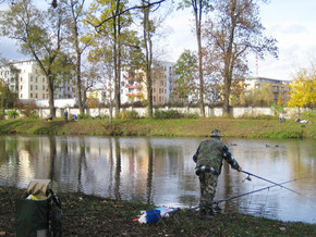 Fisherman at park pond
